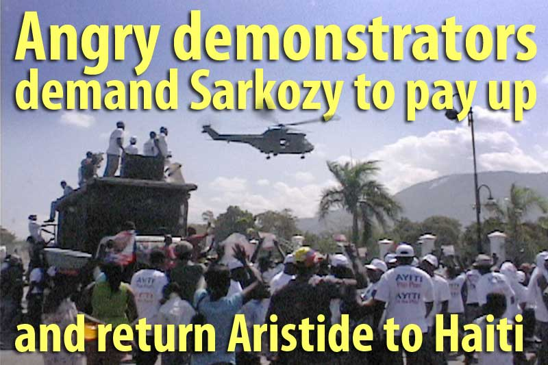 Haitians demonstrate as Sarkozy arrives
