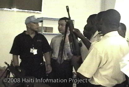 Chinese army instructor handing gun to PNH